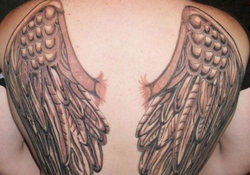 wings tattoo design the guardian angel wing tattoo designs and meaning for men. Black Bedroom Furniture Sets. Home Design Ideas