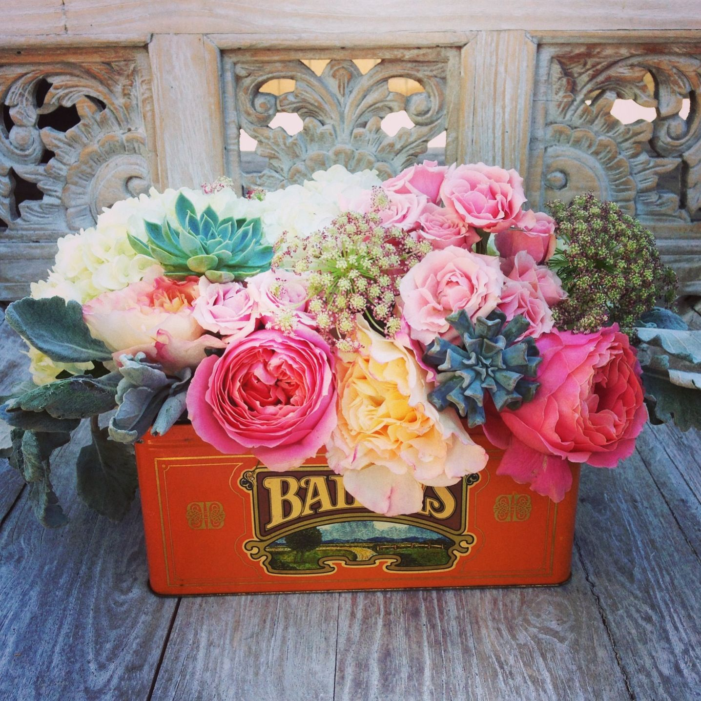 Flower centerpiece in vintage tin salmon yellow and