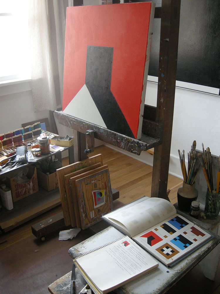 Notebooks and unfinished painting set up in Frederick Hammersley's studio in March 2012