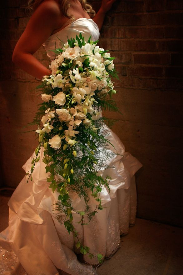 I had never seen anyone carry a long bouquet until I seen pictures online yesterday of a girl from highschools wedding- it was gorgeous!! Looked them up and found this one as an example online- love the whole ground length bouquet now!!! oneday-someday-3