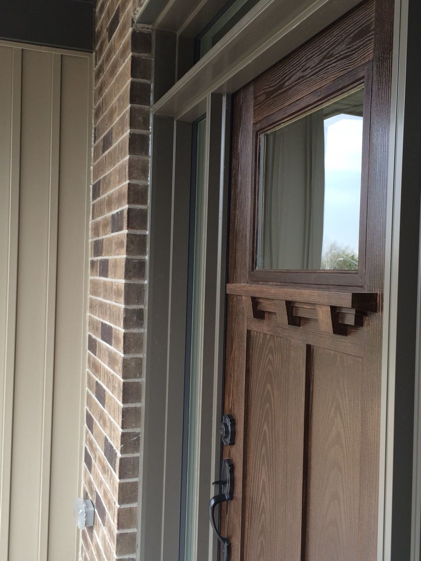 Craftsman style fibreglass Masonite door finished in a wood stain ...