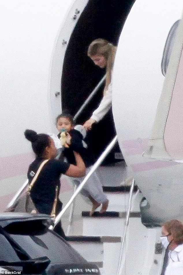 Kylie Jenner and Travis Scott arrive in LA with da