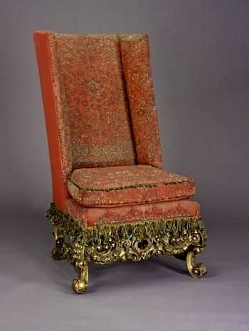 Chair of gilded walnut or softwood with gold thread embroidery on scarlet woollen upholstery, made in London for the 3rd Duke of Hamilton between 1682 and 1695, possibly by Jean Paudevin, later part of the furnishings of Queen Mary's rooms at the Palace of Holyroodhouse