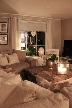 This looks like one comfy living room! I love the color scheme, too.