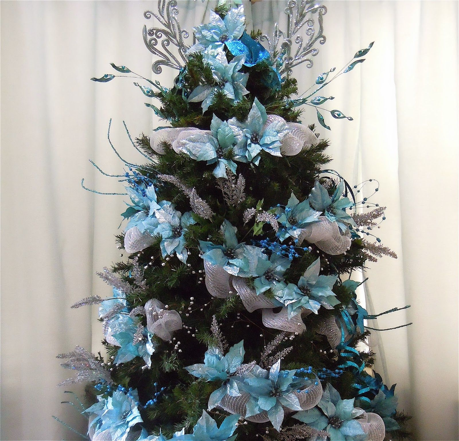 My Blue Motif Christmas Tree Decorated With Blue Poinsettia Blue Berries Silver Ribbon Gl Silver Christmas Tree Turquoise Christmas Tree Turquoise Christmas
