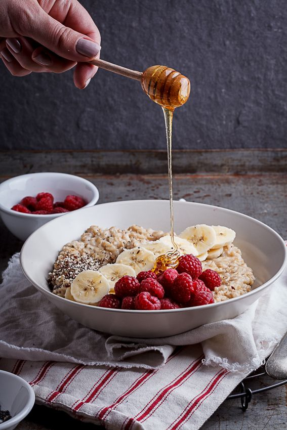 Creamy Oatmeal Bowls With Raspberries Seeds And Honey