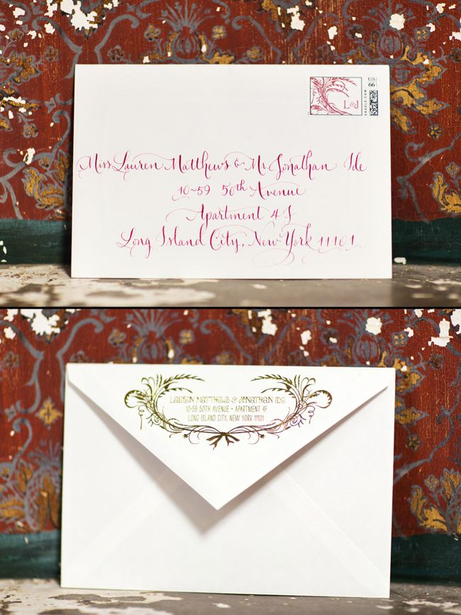 Letterpress wedding invitation envelopes with custom stamps and hand