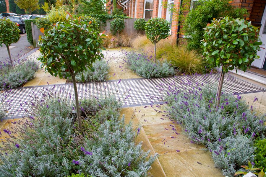 A front garden in London by Kate Eyre Garden Design with Victorian