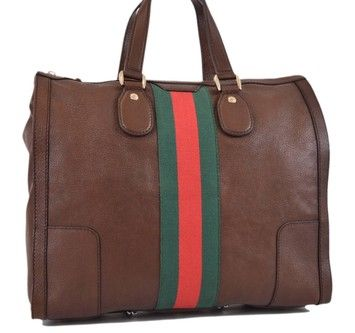 Gucci 271624 Seventies Leather Web Stripe Large New Brown Tote Bag. Get one  of the hottest styles of the season! The Gucci 271624 Seventies Leather Web  ... 44c69c8a2aecc