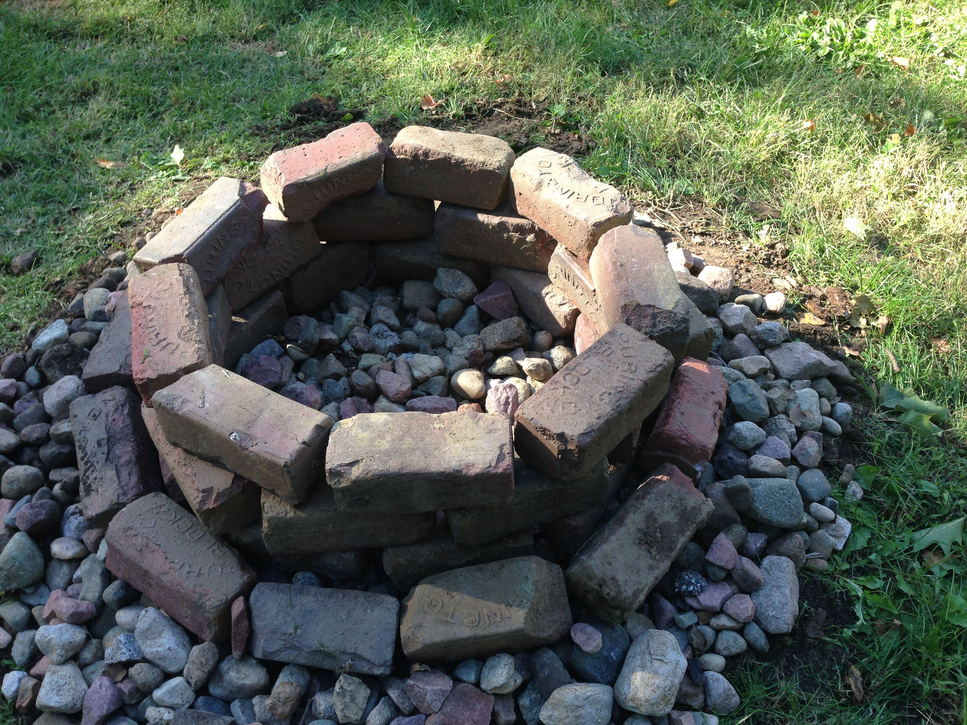 Brick and river rock fire pit. Don't forget to make clean out holes!