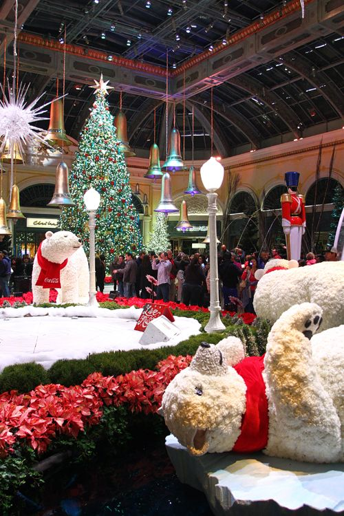 the bellagio conservatory has unveiled its christmas display including polar bears a chocolate house a giant snow globe and reindeer - Country Christmas Las Vegas