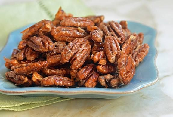 Want to give a home-made gift that your friends and family will rave about? Try these Spiced Pecans! But beware… they'll be disappointed if you don't give them more next year. 1/4 c butter ½ c packed golden brown sugar  1/4 c water  1 t salt  2 t Chinese five spice powder  ½ t cumin ½ t black pepper  4 C pecan halves Preheat oven to 350. Butter 2 large baking sheets. Melt ½ c butter in large skillet over medium heat. Add brown sugar, 1/4 c water, salt & spices.