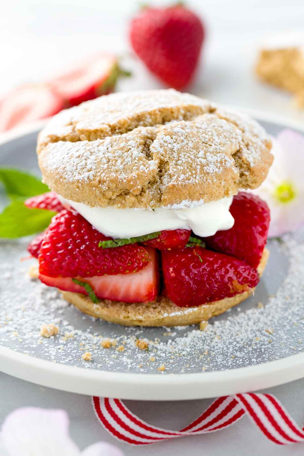 Strawberry shortcake recipe topped with ripe berries and silky whipped cream. Each cake is made with whole wheat flour for the ultimate dessert with benefits!