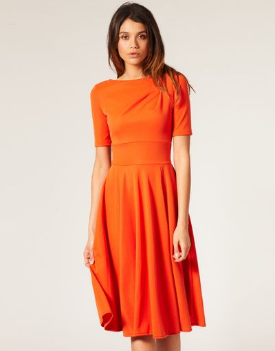 Tailored orange midi dress with a flared A line skirt is ...