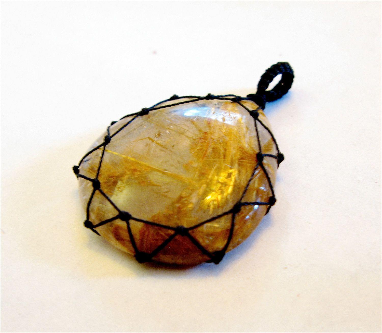 Gold Rutilated Clear Quartz Macrame Stone Pendant. $20.00, via Etsy.