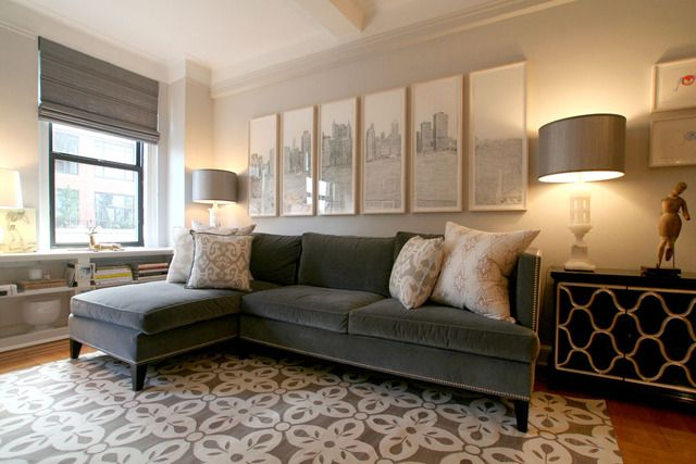 Chic city living room design with gray velvet sofa with chaise