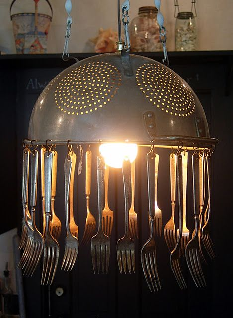 AN old colander hung with old silverware as the substitute for crystals,  the light kits are sold in craft stores, hardware stores and home improvements stores... also places like World Market have them... (save you coupon for this kit) this one would all depend on your decor.... what whimsical upcycle / recycle / green craft... not for everyone but sure cute tom me!