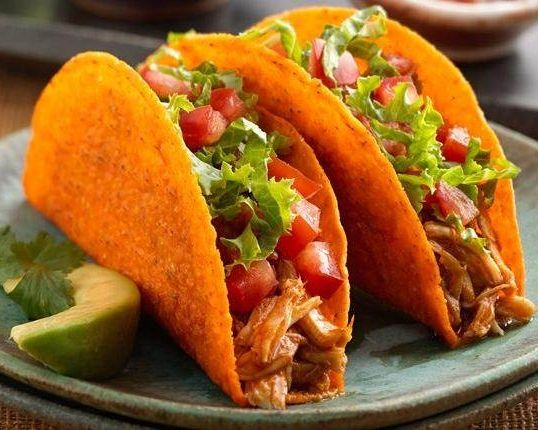 Slow down your weekend with these Slow-Cooker Chicken-Nacho Cheese Tacos! Put the chicken in your slow cooker on Sunday morning, and dinner will be ready with no fuss at all!