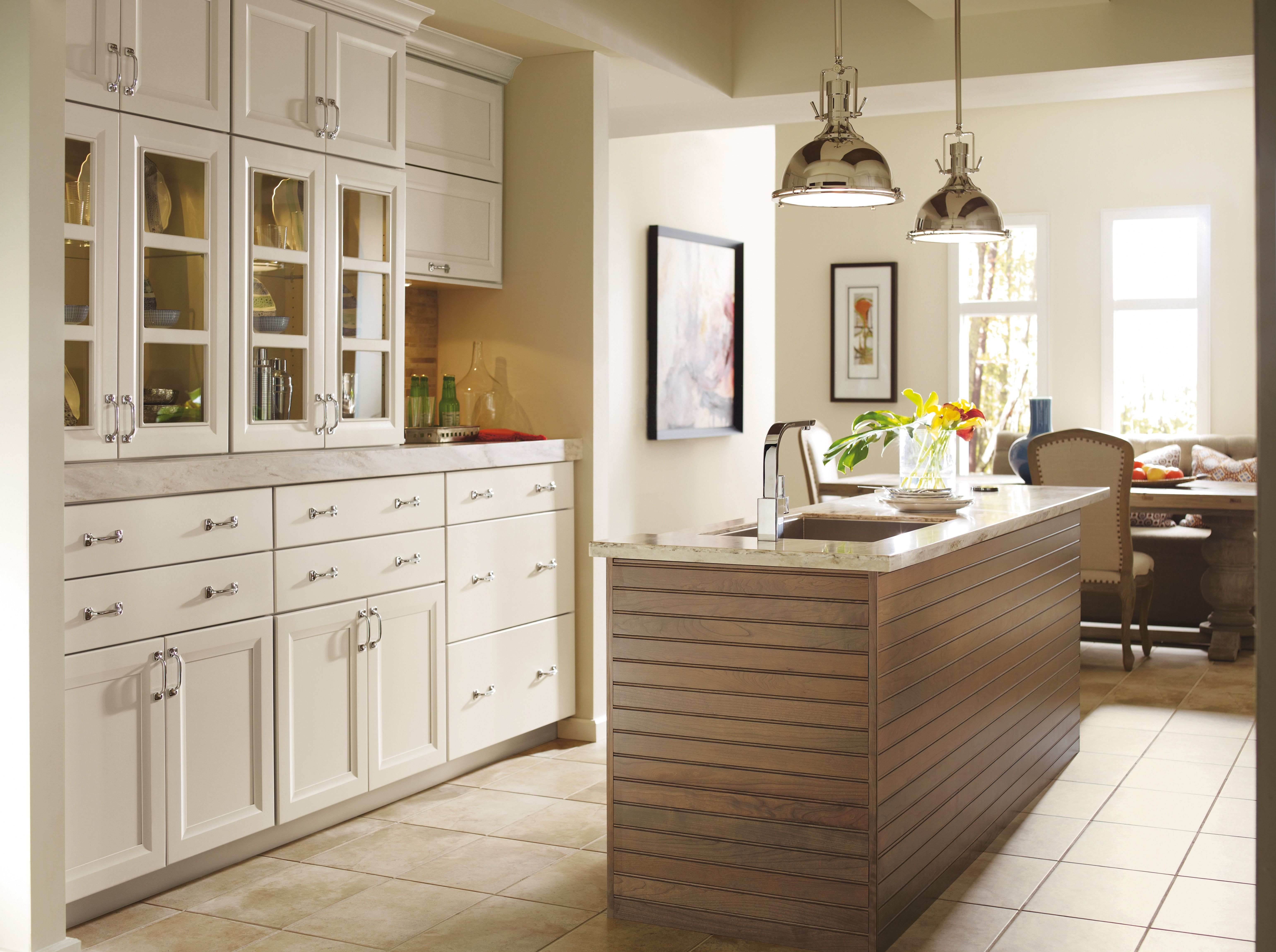 Dynasty Cabinetry In Maple Magnolia A Subtly Gray Toned White Along With Cherry Riverbed On The Island Omega Cabinetry Kitchen Cabinet Design Maple Cabinets