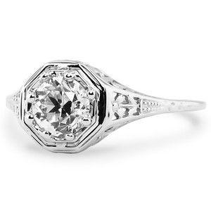 This ring reminds me of Grandmother Norton's ring.  Its from 1910.  You might want to see if your intended has any ethical issues with giving you a conflict diamond... In which case you can use Canadian diamonds or read about your options at Brilliant Earth's website.