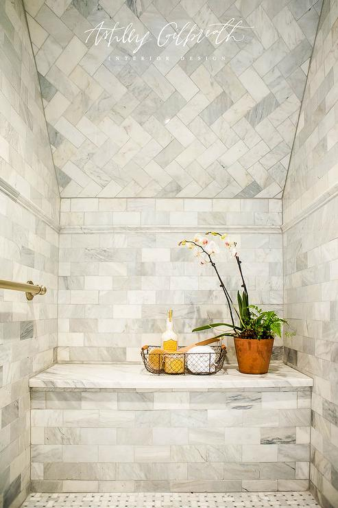 A Sloped Shower Ceiling Is Decorated With Marble Herringbone Tiles Including A Shower Bench Per Marble Herringbone Tile Shower Ceilings Sloped Ceiling Bathroom