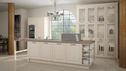 hand painted Cream shaker kitchen with wall of glass storage units and centre island