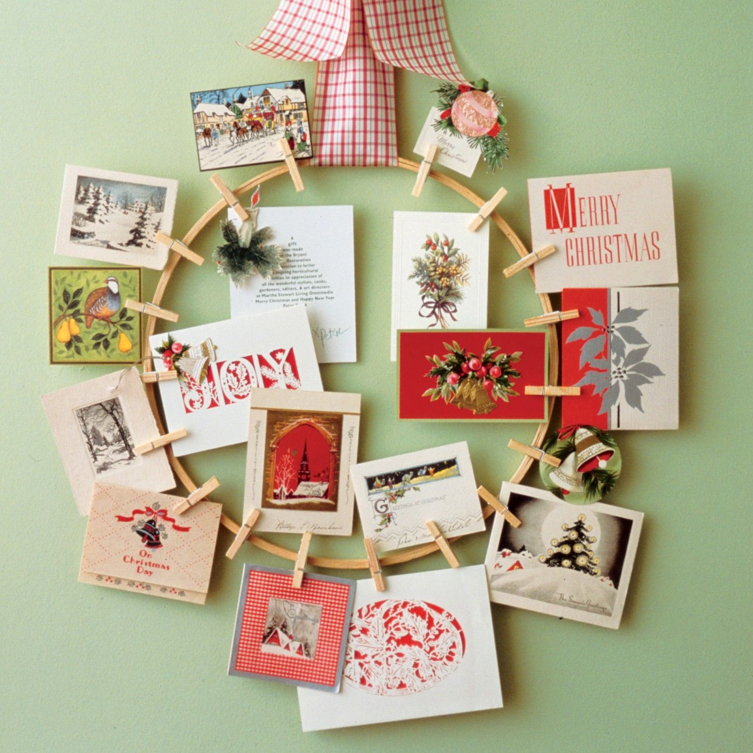 Decorate a wall or an interior door by hanging a holiday-card wreath.