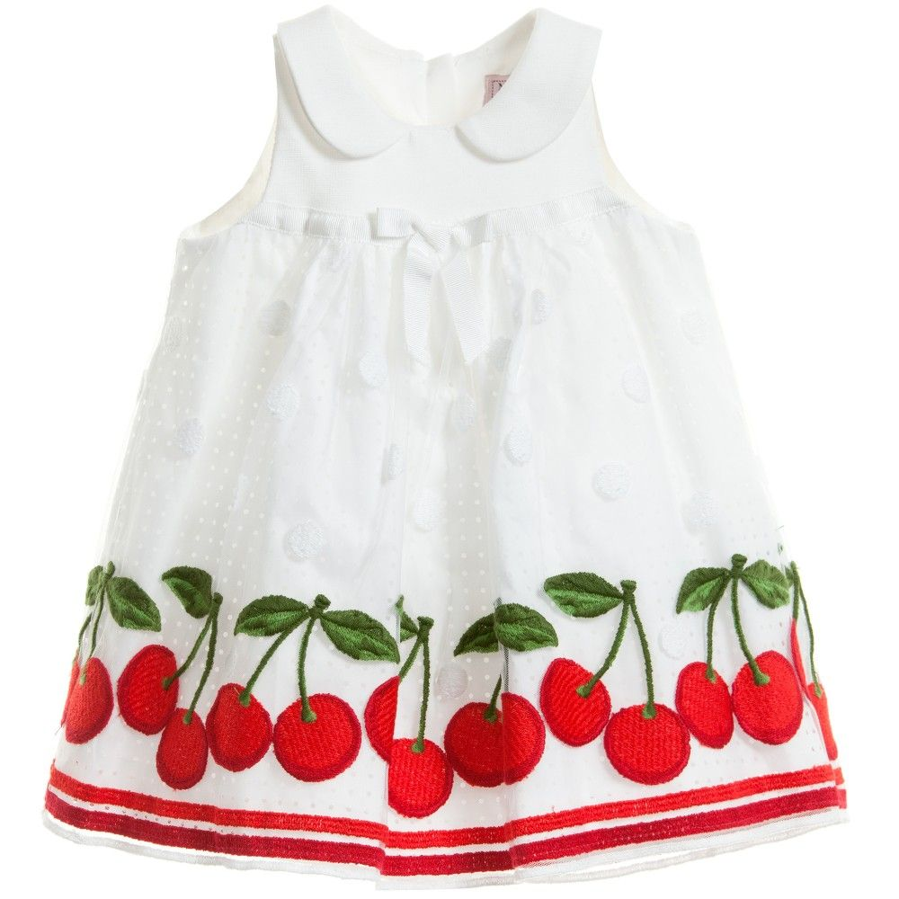Monnalisa Bebe girls stunning crisp white dress made from cotton with a smart collar and perforations that give the dress a pretty all over dotted pattern. It has adelicate, soft tulle net overlay with beautifullyembroidered rich, red cherries and fastens on the back with tiny buttons.