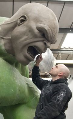 Sculptor puts the finishing touches on the anthropomorphic