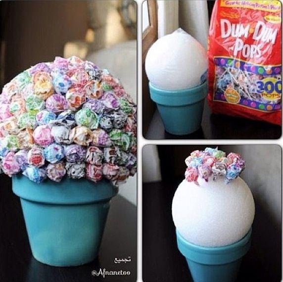 Best 25 sucker centerpiece ideas on pinterest sucker for Karneval dekoration tisch