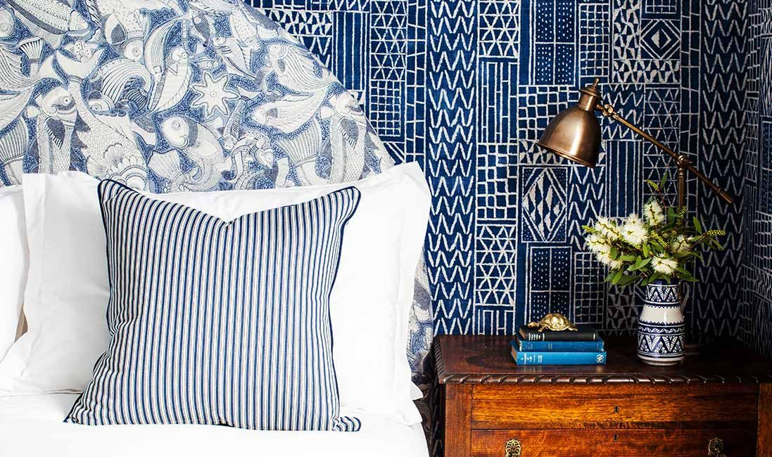 A mix of blue and white textile patterns on