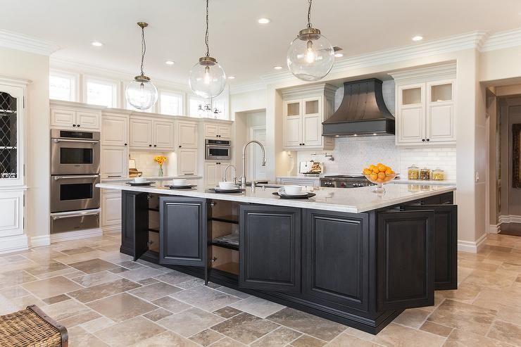 Large open concept kitchen features a generous black ...