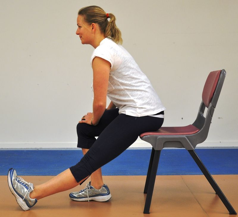 Seated Calf Stretch Sit Upright On The Edge Of Your Couch With Both Feet Flat On The Floor While Keeping Seated Hamstring Stretch Exercise Hamstring Stretch