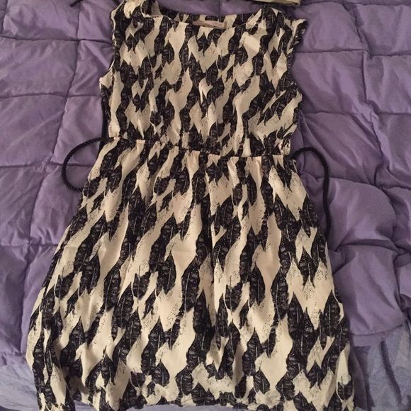 Feather Dress Dress is a crepe color with black feathers. It has only been worn once and is very soft and comfortable material. Comes with a thin belt. One end of the belt is missing. Belt can be removed from dress as well. Forever 21 Dresses Midi