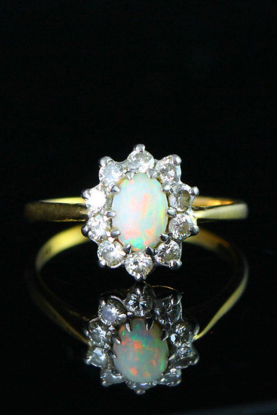 b7d05fa6baf2e8 Engagement ring Opal Diamond in 18 carat gold, cluster diamond surround oval  opal cabochon
