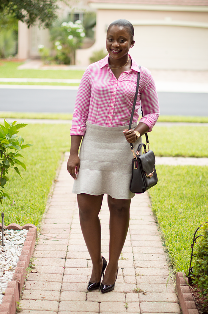 pink gingham shirt and grey flared skirt |