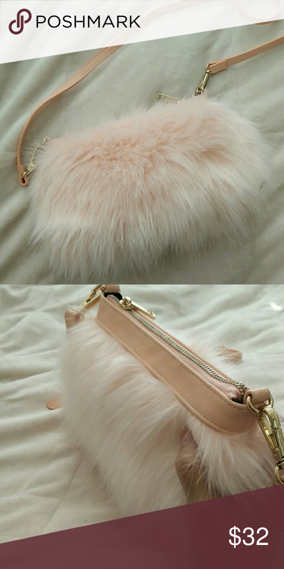 Pink Faux fur Shoulder Bag. New! Cute Light Pink Faux Fur Bag removable  straps so you can also use as a clutch. Never used Not for asos. faux furrrrrrr. Thumbs down for real fur ASOS Bags Clutches & Wristlets
