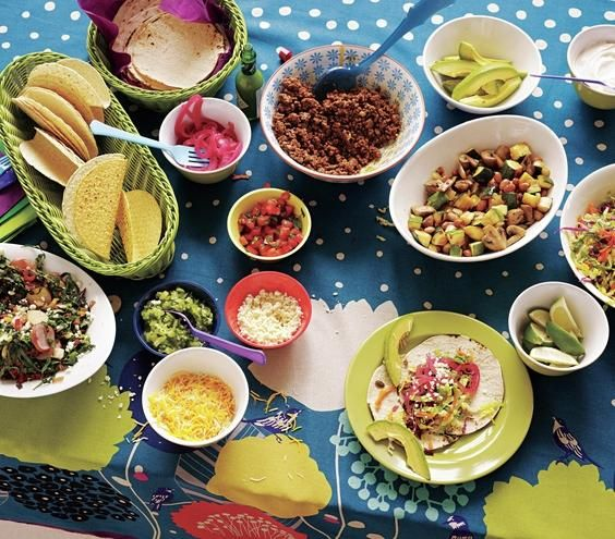 Taco bar with toppings and sides | Host a DIY buffet with kid favorites and adult-friendly fixings. You can warm both soft tortillas (wrapped in foil) and hard shells in a 350° F oven for 4 to 5 minutes. Then stuff them with these fresh and colorful fillings.
