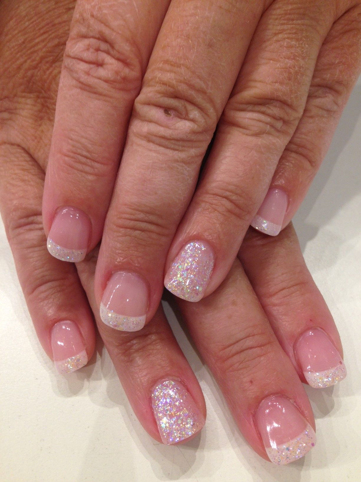 Bio Sculpture Gel French Manicure with overlay of iridescent glitter