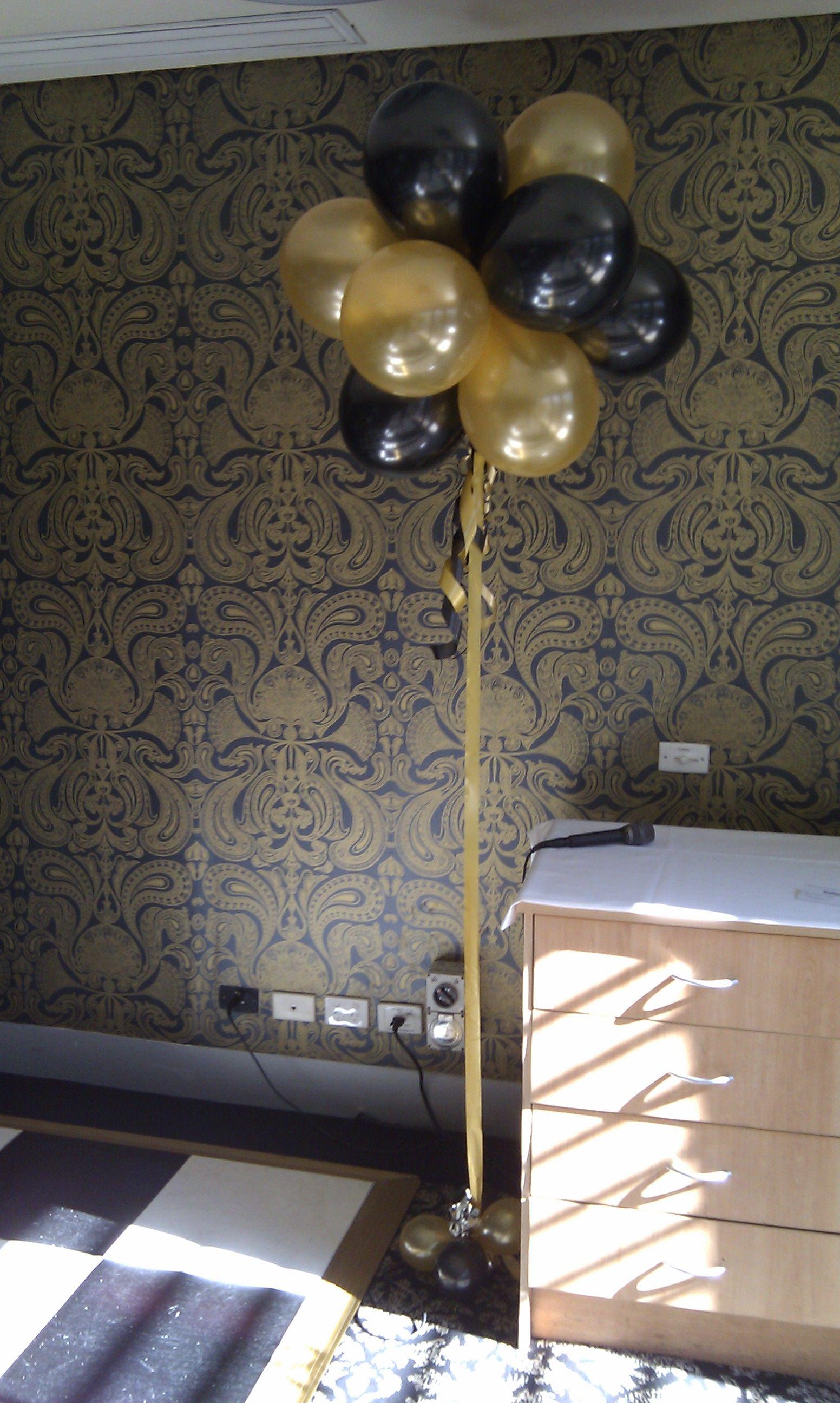Black and Gold helium topiary arrangements Black