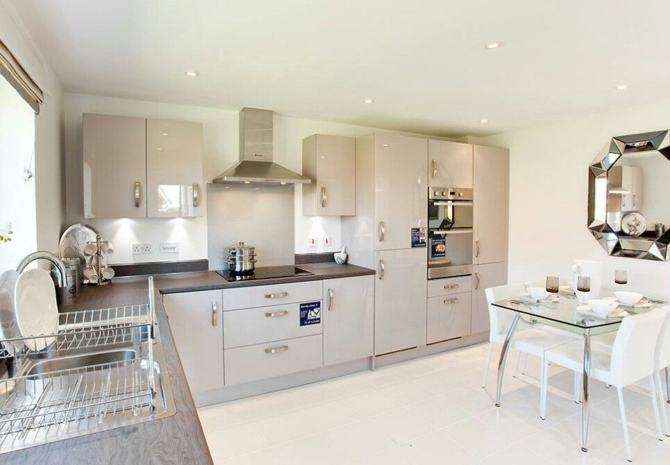 Modern Interior Designed Kitchen Dining Room Using Taupe Gloss Coloured Units Mink Wood Work Surfaces