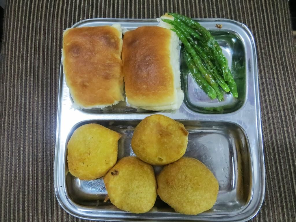 Vada pav is a popular spicy vegetarian fast food it consists of a vada pav is a popular spicy vegetarian fast food it consists of a batata vada sandwiched forumfinder Images