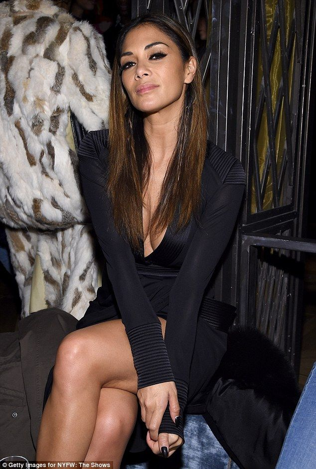 Nicole Scherzinger Shows Off Her Cleavage In A Plunging Black Gown