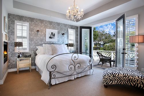 Wallpapered accent wall and classic chandelier!