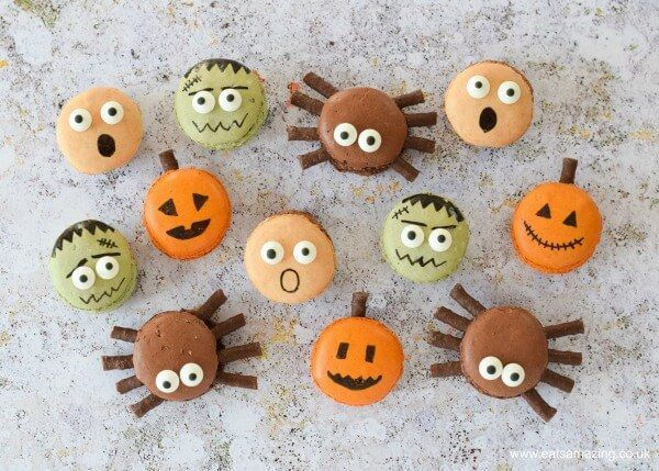 4 Fun and Easy Halloween Macarons #halloweenmacarons How to make Halloween macarons - fun designs including pumpkin spiders frankenstein and screaming macarons - Eats Amazing #halloweenmacarons