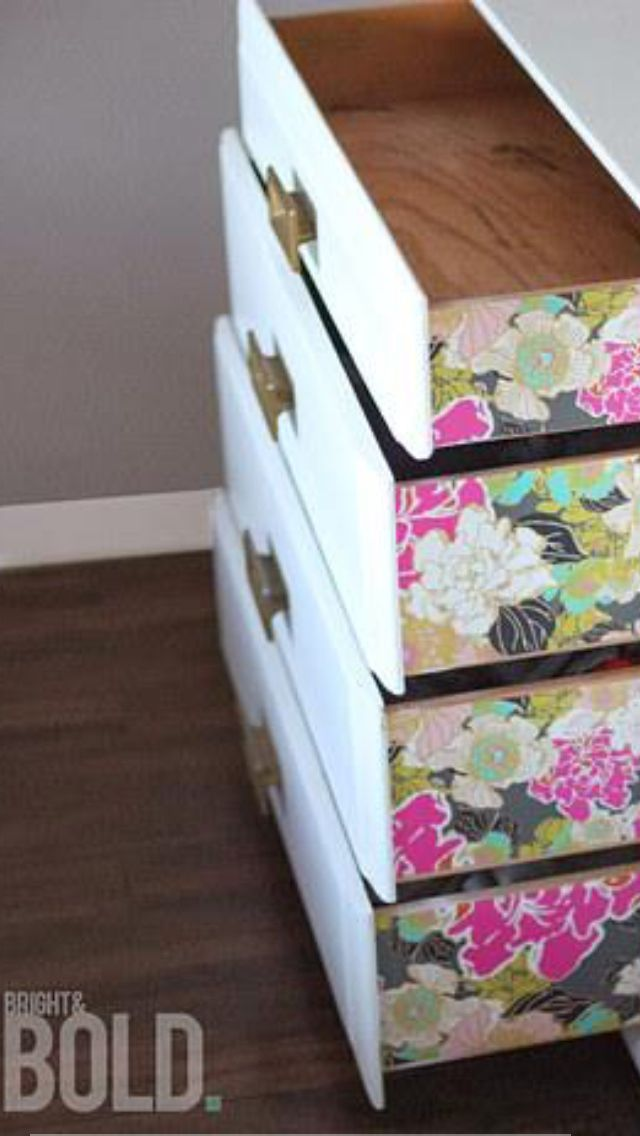 Put wallpaper on drawers for a pop