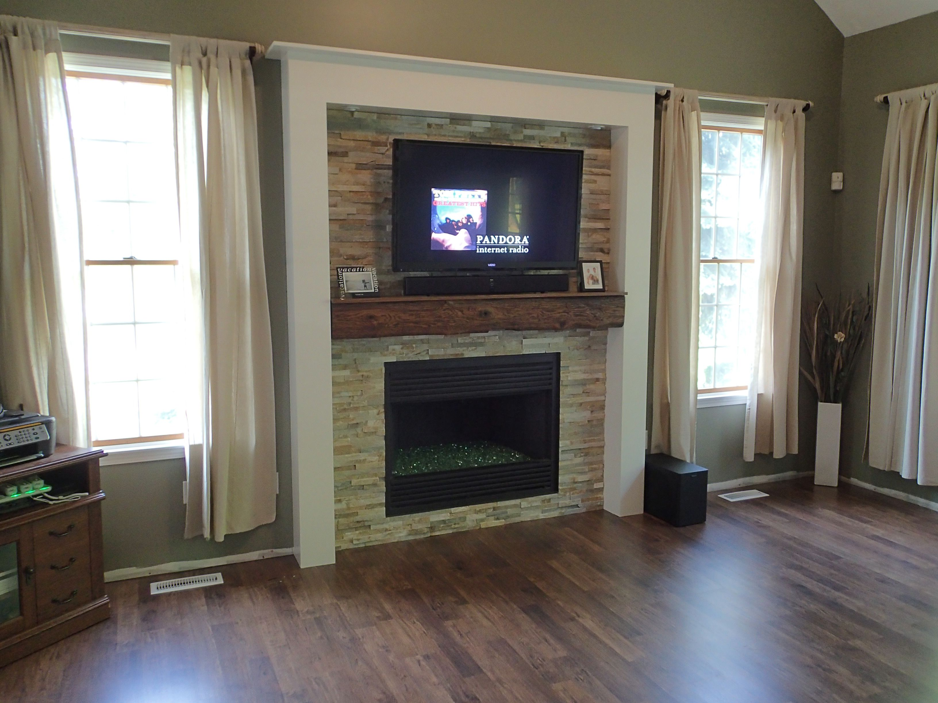 Our new fireplace real stone beams old barn beam mantel t glass