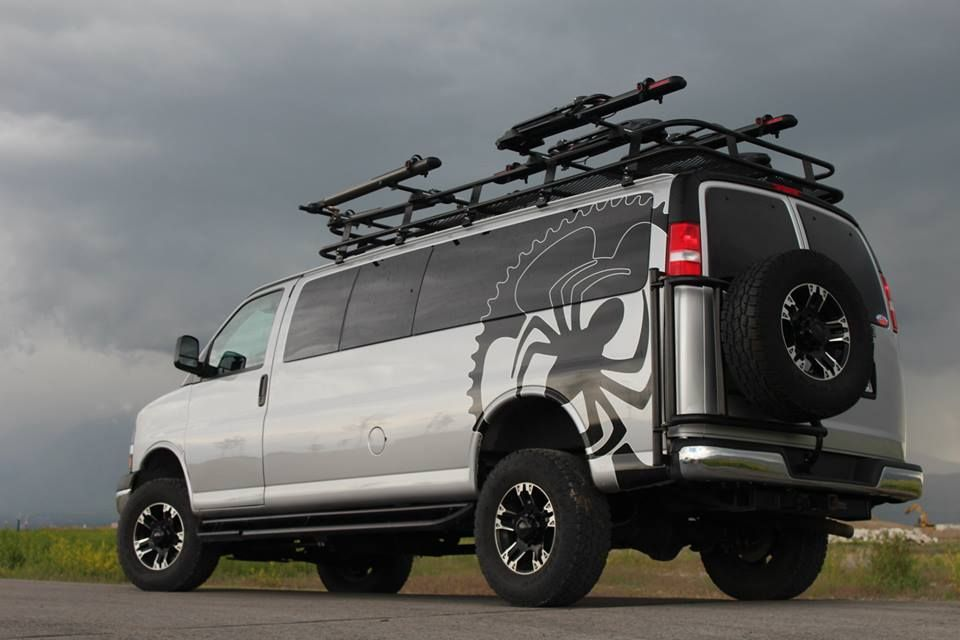 Love this GM 4x4 van! Aluminess roof rack and tire carrier