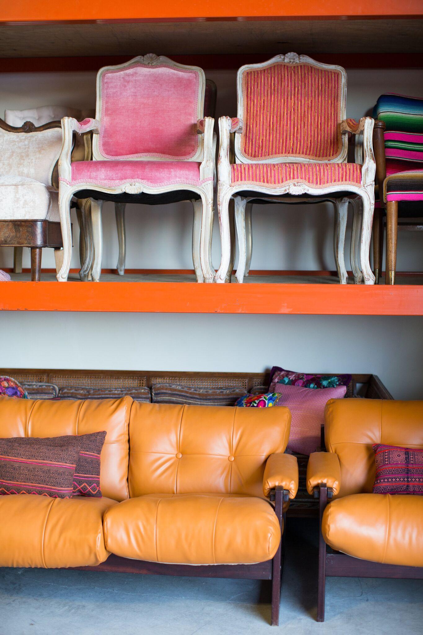 Wedding and event rental companys warehouse with vintage furniture in austin texas via birch brass vintage rentals