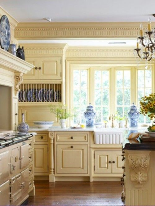Country fresh yellow kitchen with blue accents from the dinnerware and accessories pretty - Serene traditional cottage in natural theme ...
